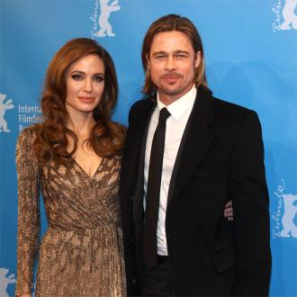 Brad Pitt Can't Keep His Hands Off Angelina Jolie