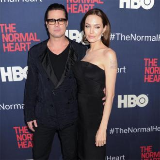 Angelina Jolie Admits It's Not Easy Directing Brad Pitt