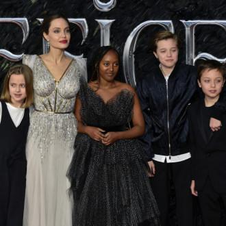 Angelina Jolie lets her kids raid her closet