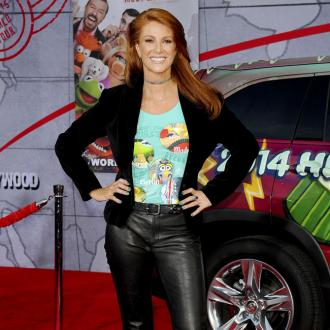 Angie Everhart had surgery on neck