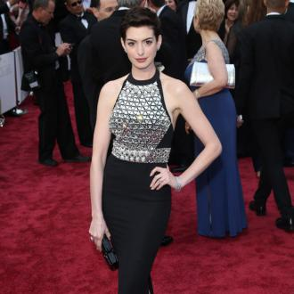 Anne Hathaway Took Flash To Oscars