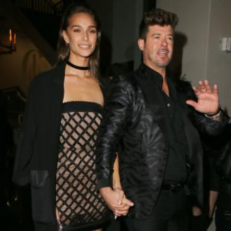 Robin Thicke and April Love Geary safe after being involved in car accident