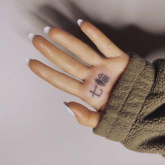 Ariana Grande's Tattoo Pays Homage To Charcoal Grill