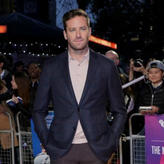 Armie Hammer wears lucky pyjamas to fly