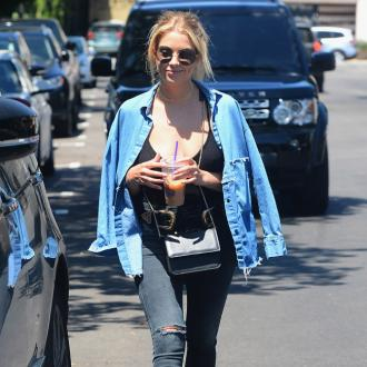 Ashley Benson is 'happy' in her home