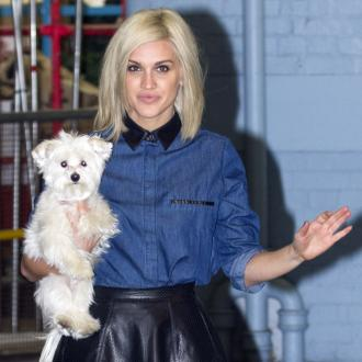Ashley Roberts has 'hugging guru'