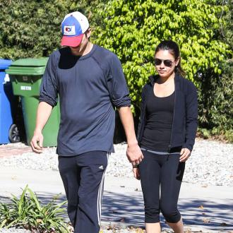 Ashton Kutcher And Mila Kunis Attend Funeral