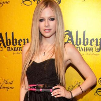Avril Lavigne still 'friends' with ex-husbands