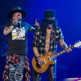 Slash says Axl Rose has been 'so professional' during Guns N' Roses reunion