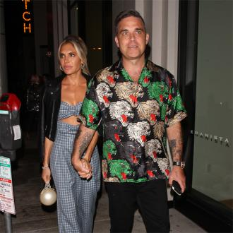 Ayda and Robbie living in 'pink love bubble'