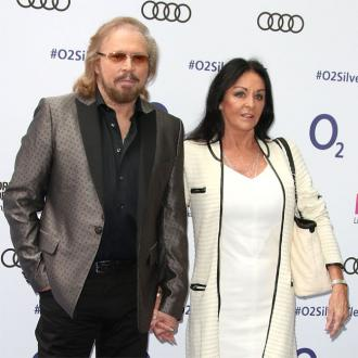 Barry Gibb met his wife through Jimmy Savile