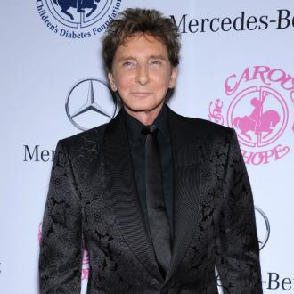 Barry Manilow doesn't get sick of singing his famous songs