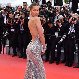 Bella Hadid has a brand name burnt onto her back