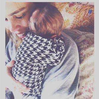 Billie Piper unveils baby girl