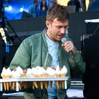 Blur's Damon Albarn hands out ice creams
