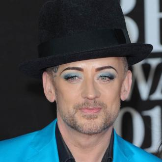 Boy George Stops Head Tattoos