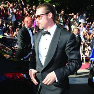 Brad Pitt Hides Behind Walls