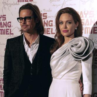 Brad Pitt And Angelina Jolie Are The Thick Of It Fans