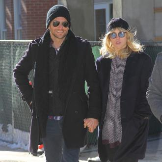 Bradley Cooper is still madly in love