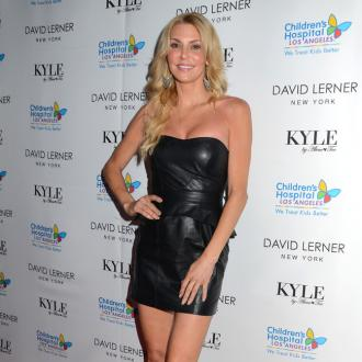 Brandi Glanville rescues puppy from homeless man