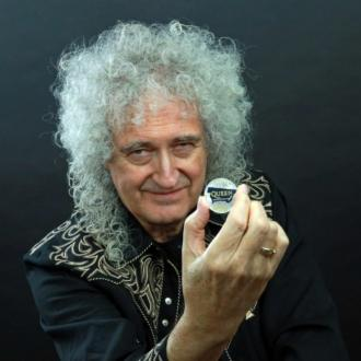 Queen become first band ever to be honoured on UK coin