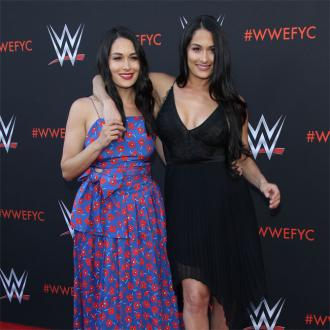 Nikki and Brie Bella gave birth 'right next to each other'