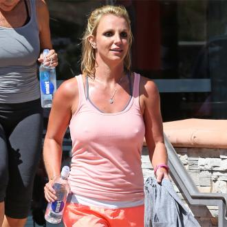 Britney Spears wears mini shirts for chores