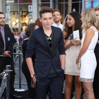 Brooklyn Beckham Supports Chloe Moretz At Premiere