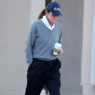 Bruce Jenner Being Supported By Daughters