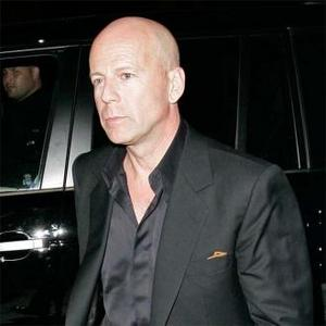 Bruce Willis Angry About Rihanna Pictures?