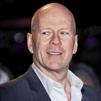 Bruce Willis Moves Into Demi Moore's Building