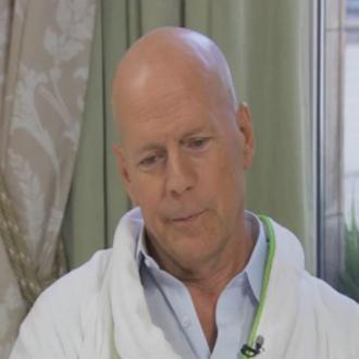 Bruce Willis Wears Bathrobe For Interview