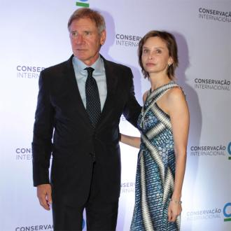 Harrison Ford is leaning on Calista Flockhart
