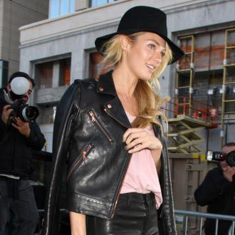 Candice Swanepoel's Kept In 'High Spirits' On Shoot