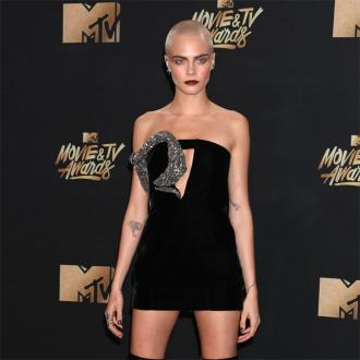 Cara Delevingne shows off head tattoo at MTV Movie and TV Awards