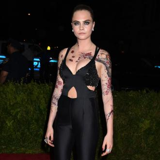 Cara Delevingne Rocks Oriental-inspired Body Art At Met Gala