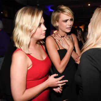 Cara Delevingne begs fans to stop 'hating on' Ashley Benson
