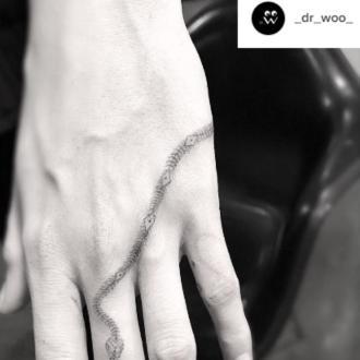Cara Delevingne's snake tattoo