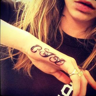 Cara Delevingne Gets Initials Tattooed On Hand