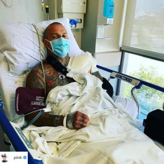 Pink dubs husband Carey Hart 'bionic man' after 'successful' shoulder surgery