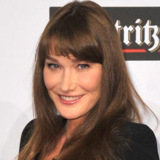 Carla Bruni Stays Stylish In A Suit