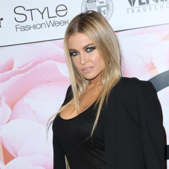 Carmen Electra hasn't ruled out remarrying ex Dave