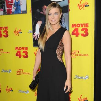 Carmen Electra Wants To Adopt