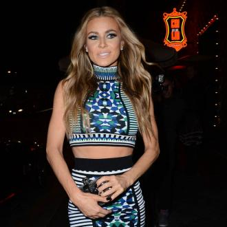 Carmen Electra stays fit by dancing