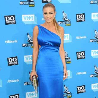 Carmen Electra is 'happily single'