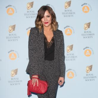 Russell Brand invites Caroline Flack to his self-help seminar