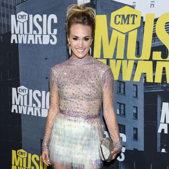 Carrie Underwood plans outfit changes ahead of the CMA Awards