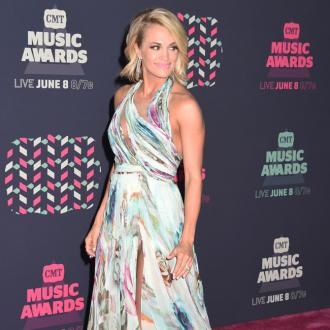 Carrie Underwood was 'dying' to tells fans about her pregnancy