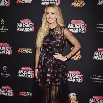Carrie Underwood says her son is a 'schmoozer'