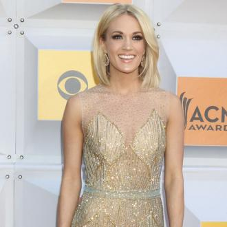 Carrie Underwood's son helps around the house